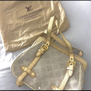 Cream snake patterned Louis Vuitton bag